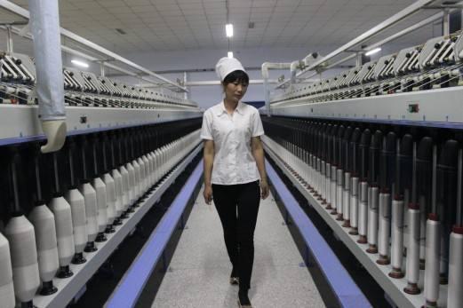 """纺织企业扎堆走进新疆 """"棉花+政策""""激发投资热情0.jpg"""